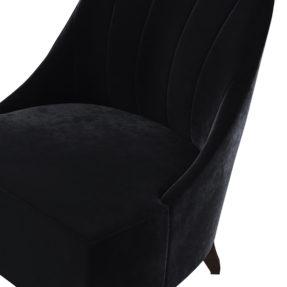Дорогое велюровое черное кресло на ножках
